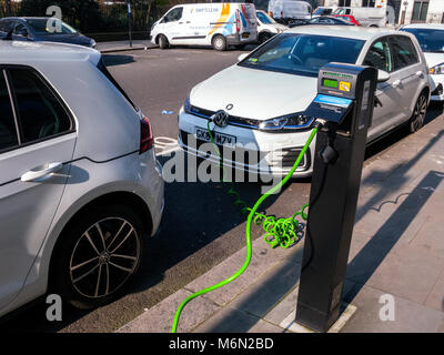 Electric Car being charged at street chargepoint, London - Stock Photo