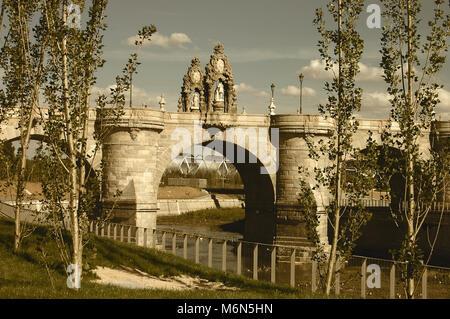 Vintage toned image of the Toledo bridge over the Manzanares river in Madrid. Spain. - Stock Photo