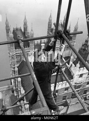Construction worker erecting scaffolding on the 'Big Ben' clock tower on the Houses of Parliament also called Palace - Stock Photo