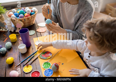 Family Painting Easter Eggs for Holiday - Stock Photo
