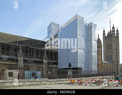 Scaffolding spans St Stephens Hall, part of the Palace of Westminster, and Houses of Parliament, London, UK. Part - Stock Photo