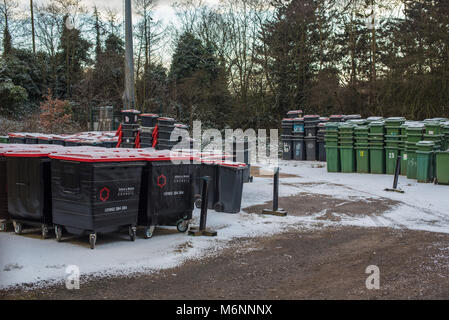 A yard full of unused and empty wheelie bins - Stock Photo