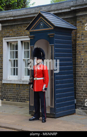 The Queens guard outside Clarence house in London - Stock Photo