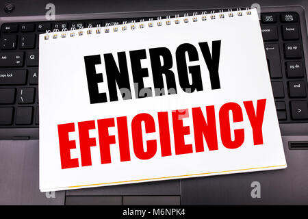 Handwritten text showing Energy Efficiency. Business concept writing for Electricity Ecology written on notepad - Stock Photo