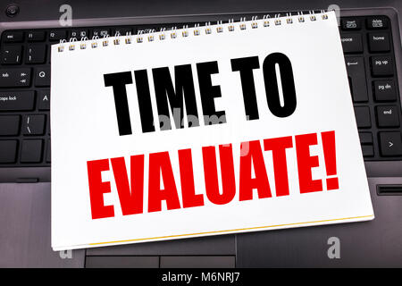 Handwritten text showing Time To Evaluate. Business concept writing for Assessment Evaluation written on notepad - Stock Photo