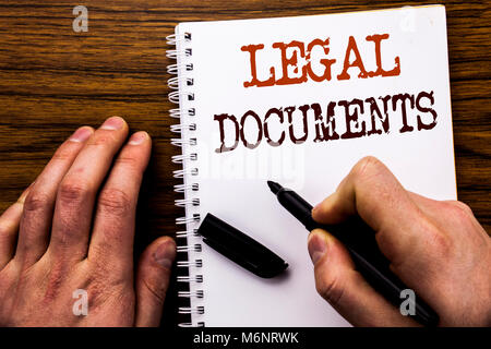 Handwritten text showing word Legal Documents. Business concept for Contract Document Written tablet laptop, wooden - Stock Photo
