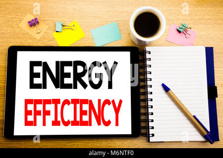 Word, writing Energy Efficiency. Business concept for Electricity Ecology Written on tablet, wooden background with - Stock Photo