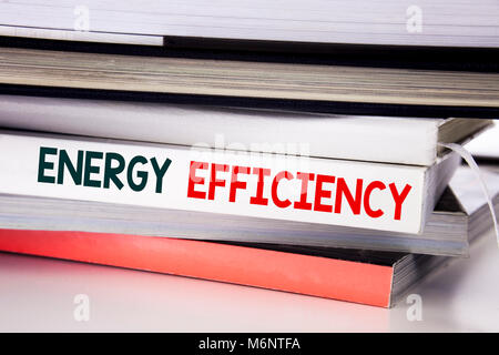 Word, writing Energy Efficiency. Business concept for Electricity Ecology written on the book the white background. - Stock Photo