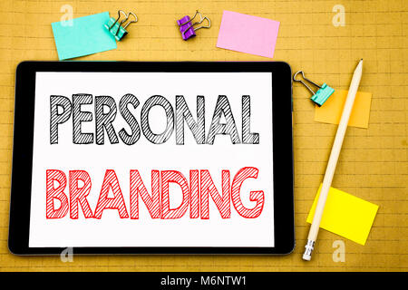 Word, writing Personal Branding. Business concept for Brand Building Written on laptop, wooden background with sticky note and pen