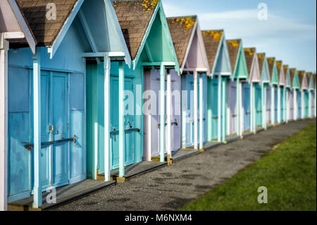 row of pastel colour beah huts in Southsea, UK - Stock Photo