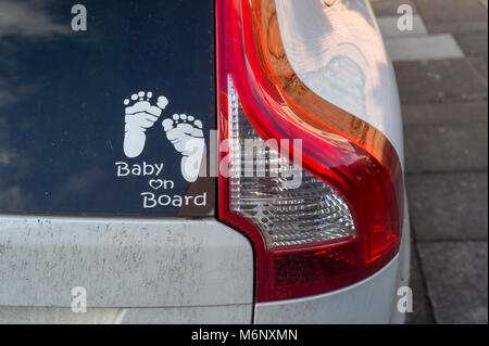 Baby on Board sign in the back of a car - Stock Photo