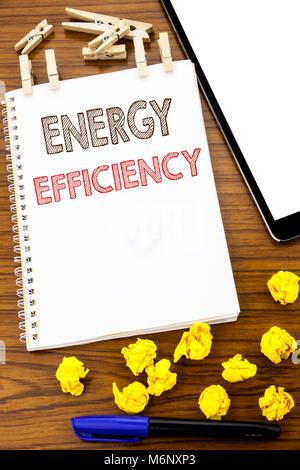Writing text showing Energy Efficiency. Business concept for Electricity Ecology written on note paper folded Meaning - Stock Photo