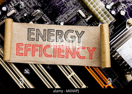 Writing text showing Energy Efficiency. Business concept for Electricity Ecology Written on sticky, computer main - Stock Photo
