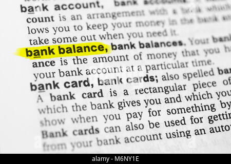 Highlighted English word 'bank balance' and its definition in the dictionary. - Stock Photo