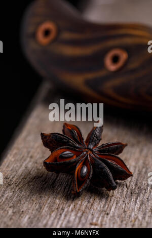 Anise on a wooden background. Badyan. - Stock Photo