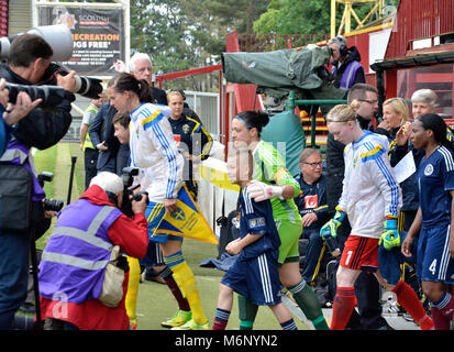 MOTHERWELL, SCOTLAND - JUNE 14th 2014: The Scotland and Sweden's national football team come out of the tunnel in - Stock Photo