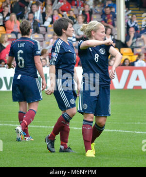 MOTHERWELL, SCOTLAND - JUNE 14th 2014: Scotland's Megan Sneddon, Kim Little and Jo Love getting ready for a Sweden - Stock Photo