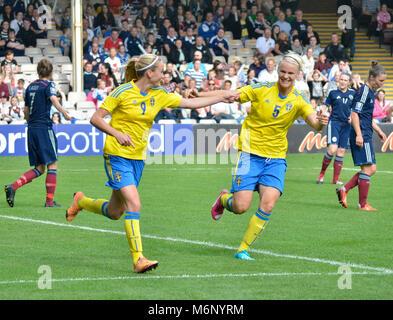 MOTHERWELL, SCOTLAND - JUNE 14th 2014: Kosovare Asllani and Nila Fischer celebrate a goal against Scotland in a - Stock Photo