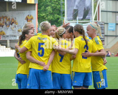 MOTHERWELL, SCOTLAND - JUNE 14th 2014: Sweden in a huddle after a goal against Scotland. This was a 2015 World Cup - Stock Photo