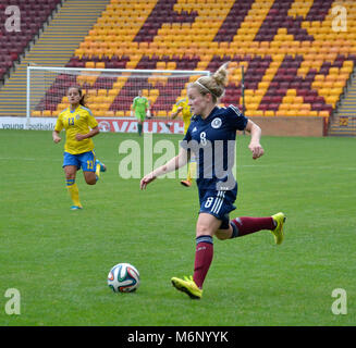 MOTHERWELL, SCOTLAND - JUNE 14th 2014:  Scotland's Kim Little heading towards the Swedish goals. This was a 2015 - Stock Photo