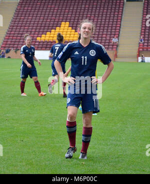 MOTHERWELL, SCOTLAND - JUNE 14th 2014: Scotland's Lisa Evans disappointed after her shot went wide. This was an - Stock Photo