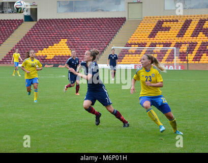 MOTHERWELL, SCOTLAND - JUNE 14th 2014:  Scotland's Hayley Lauder trying to get to the ball. 2015 World Cup qualifying - Stock Photo