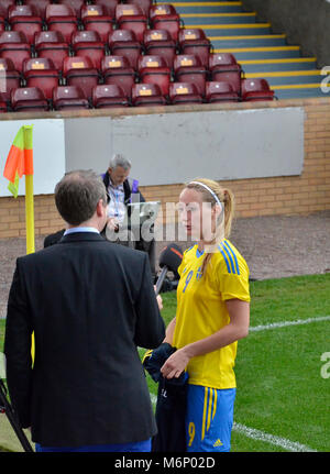 MOTHERWELL, SCOTLAND - JUNE 14th 2014:  Kosovare Asllani talking to Swedish media after the 2015 World Cup qualifying - Stock Photo