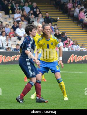 MOTHERWELL, SCOTLAND - JUNE 14th 2014: Scotland's Megan Sneddon defending against Sweden's Lotta Schelin. - Stock Photo