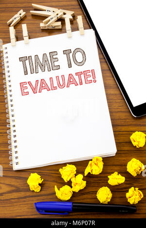 Writing text showing Time To Evaluate. Business concept for Assessment Evaluation written on note paper folded Meaning - Stock Photo