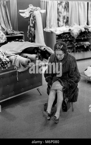 1970s real fur coat older fashionably dressed lady shopping in department store London 1970s UK HOMER SYKES - Stock Photo