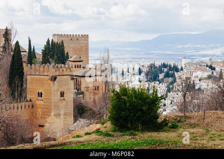 Granada, Andalusia, Spain - January 24th, 2010 : Alhambra palace towers and Albaicin district with Torre de los - Stock Photo