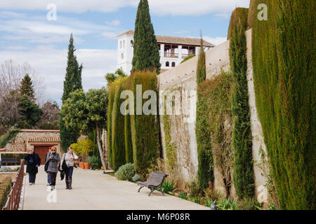 Granada, Andalusia, Spain : Tourists walk in the gardens of the Generalife palace inside the Alhambra and Generalife - Stock Photo