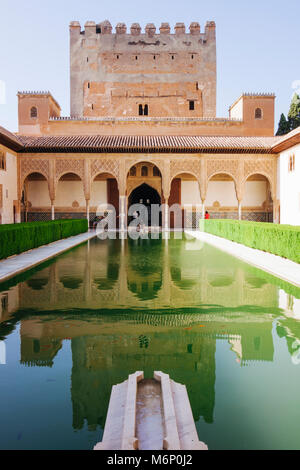 Granada, Andalusia, Spain - July 18th, 2010 : Tower of Comares and reflecting pool in the Court of the Myrtles (Patio - Stock Photo