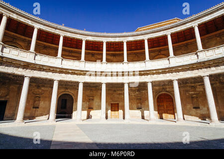 Circular patio of the Renaissance Palace of Charles V (1527). The structure was commanded by Charles V, Holy Roman - Stock Photo