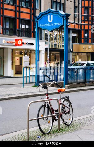 Bicycle outside the Französische Straße Berlin U-Bahn underground station. Berlin, Germany - Stock Photo