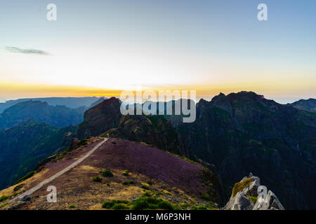 Sunset shot from the top of Pico do Arieiro Madeira island in Portugal showing a hiking track - Stock Photo