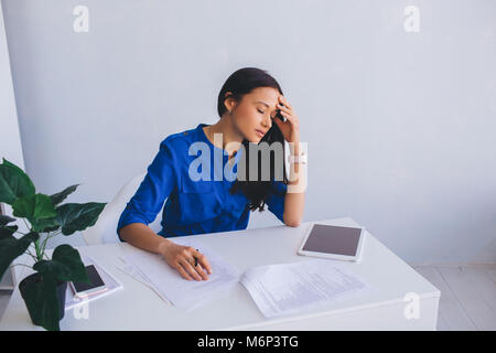 woman feeling stress and tiredness from work - Stock Photo