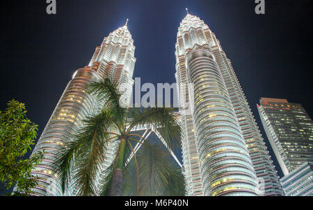 Cityscape scene at night of Petronas Towers, Kuala Lumpur City Centre (KLCC), Kuala Lumpur, Malaysia - Stock Photo