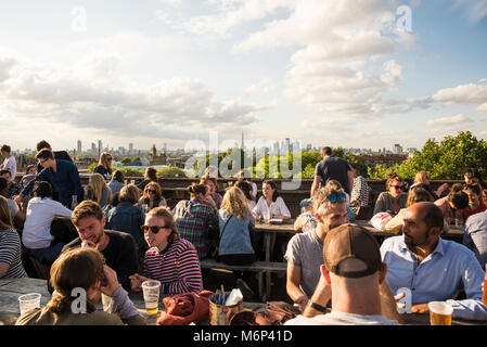 People socialising and enjoying a drink together at Franks Cafe outdoor rooftop bar with spectacular view of the - Stock Photo