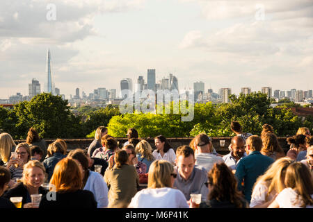 Young people socialising, enjoying a drink together at Franks Cafe outdoor rooftop bar and restaurant in Peckham, - Stock Photo