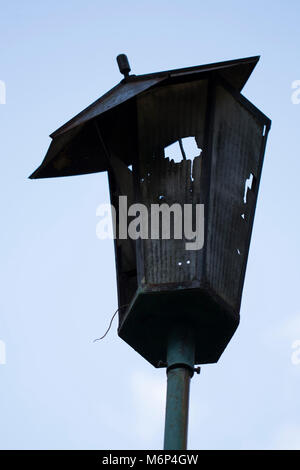 Broken hooligans street lamp - Stock Photo