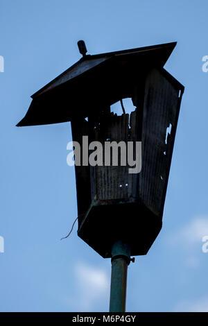Broken hooligans street lamp - Stock Photo