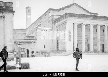 Monochrome of the O2 Guildhall and the Civic Centre Clock Tower in Guildhall Square during heavy snowfall in Southampton, - Stock Photo