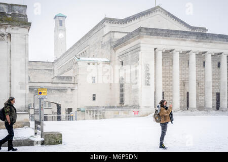 The O2 Guildhall and the Civic Centre Clock Tower in Guildhall Square during winter and heavy snowfall in Southampton, - Stock Photo