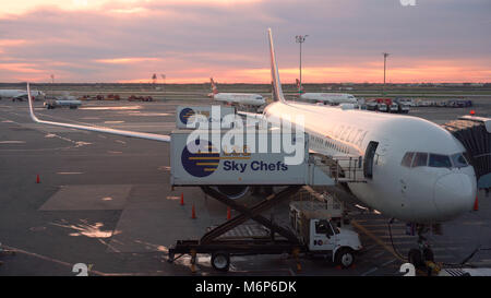 New York City - Circa 2017: Delta Airlines airplane at JFK international airport loading food, supplies and passengers - Stock Photo