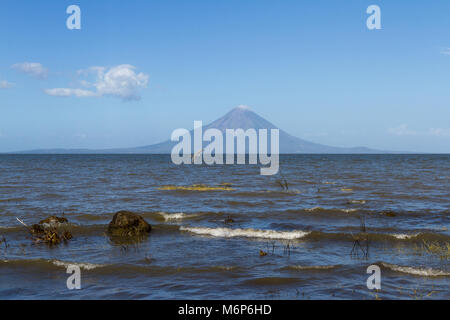 Concepcion Volcano in Nicaragua viewed from across the lake on a sunny afternoon - Stock Photo