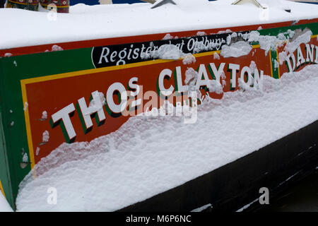 A narrowboat in winter with snow on it, Grand Union Canal, Warwick, UK - Stock Photo