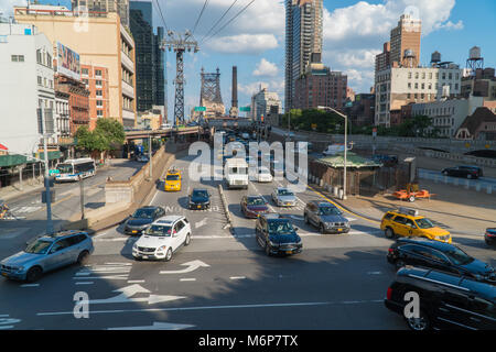 New York City, Circa 2017: Traffic enters Manhattan from the Ed Koch Queensboro Bridge during day time commute. - Stock Photo