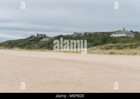 Beautiful exterior view of beach front luxury real estate homes along the ocean coast. Overcast day view from the - Stock Photo