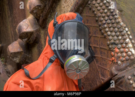 Mannequin dressed in a chemical protection suit. nuclear industry - Stock Photo